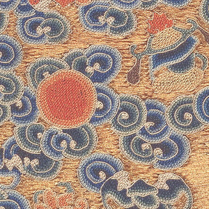Mandarin square (P'u tzu) for civil official of the eighth rank.  Embroidery in colored silks and gold thread shows quail against a golden sky, with cloud and water forms and auspicious symbols. Lined with blue silk.