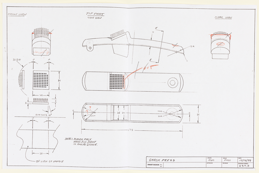 Multiple views a garlic press seen in profile, from above, and in cross-section through the length of the tool; at left are three views of the tool seen from the front in profile, in plan, and in cross-section with dimensions; at far right is a view of the tool from the rear.  Requested revisions to the drawing are indicated in red pencil or graphite.  The drawing space is framed by a printed ruled line, and there is a title block at along the lower margin, right.