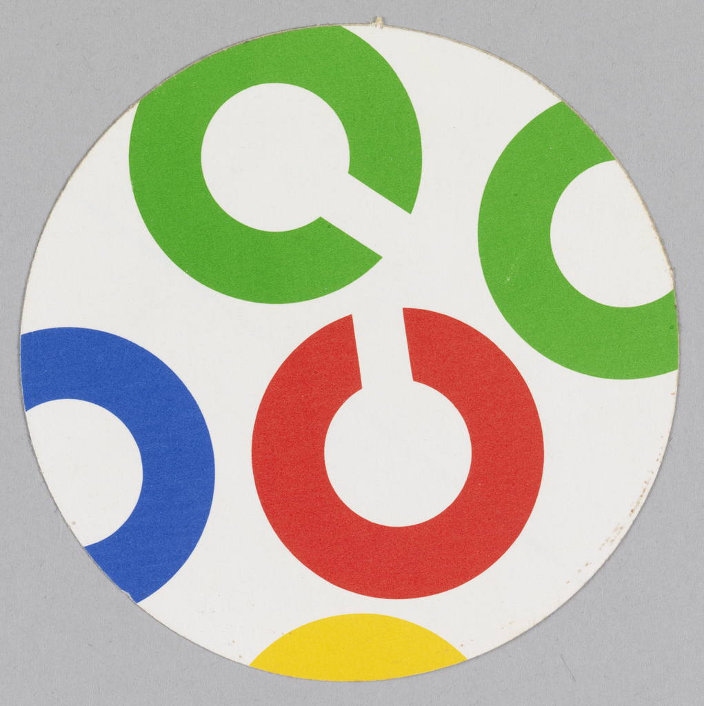 """Round sticker with adhesive on back imprinted, seemingly at random, with the Rand-designed """"C"""" logo (shaped like a circle and cut off at edges) in blue, green, red, and yellow."""