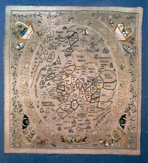 Map of England and Wales within an oval frame. Butterflies and baskets at each corner.