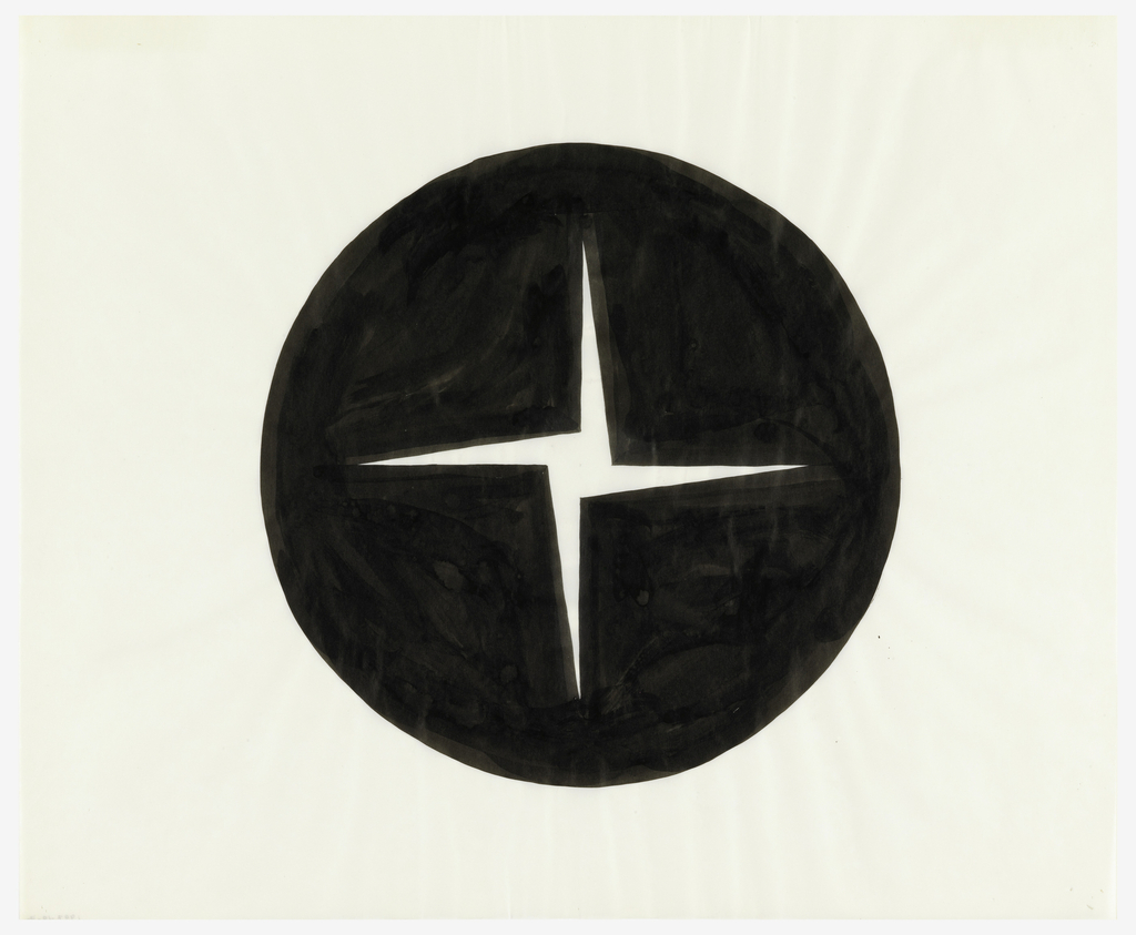 Black circle containing four pointed pinwheel form, vertically oriented in the center of the sheet.