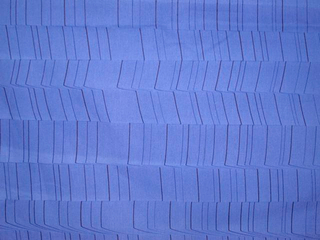 Bright blue ground with fine lines of deeper blue, shifted at irregular intervals to create the illusion of three-dimensional vertical columns.