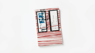 Red striped white card with address label: Bruno Grizzo / 200 East 33rd Street / Apt. #21i / New York. NY 10016. Above, in a black frame three postal stamps and one black ink stamp.