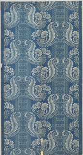 On bright blue ground, foliate scrolls in repeating patterns forming vertical bandings in white and light blue.