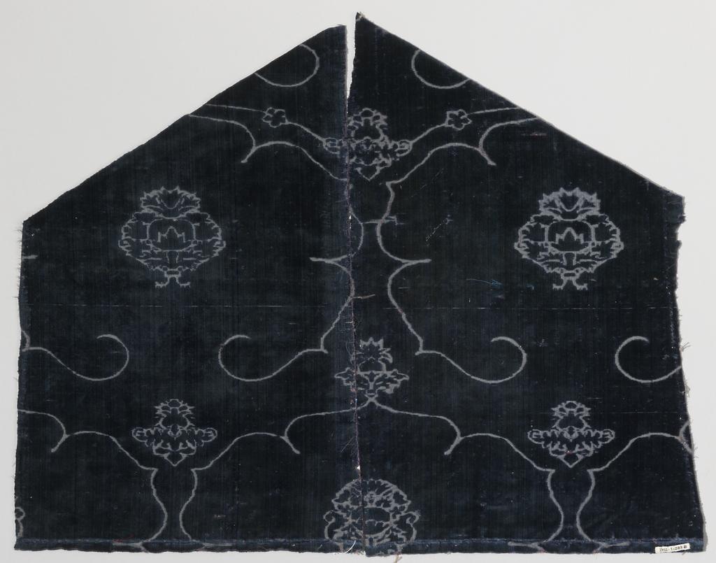 Blue voided velvet of the ferronerie type with design based on the pomegranate motif.