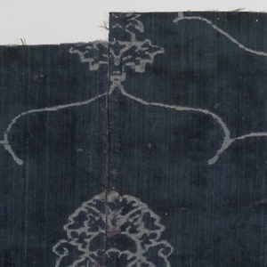 Blue voided velvet of the ferronerie type with design based on the pomegranate motif.