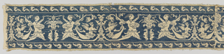 Long band of linen, pieced in four places, embroidered in blue. The design is reserved in the ground of the linen, the background solidly worked with embroidery stitches. Design consists of fantastical mermaid-like figures in profile confronted on either side of a fountain-like structure. Figures alternate with smaller-winged confronted grotesques. Narrow cream looped fringe trims the top and bottom edges.