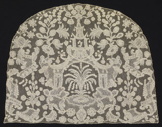 Cap crown of Brussels bobbin lace with a design of a fountain surmounted by chinoiserie pavilion and flanked by floral and foliated sprays and rocaille decoration.
