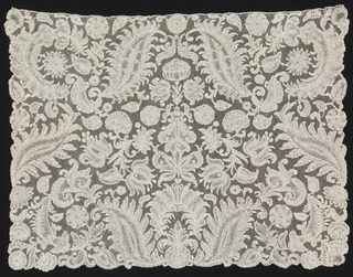 Cravat with symmetrically placed floral and foliated forms in an allover pattern.