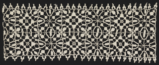Wide border of two rows of squares filled with geometrically balanced floral shapes.