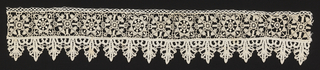 Border of  small squares filled with rosettes and edged on one side by Venetian bobbin lace.