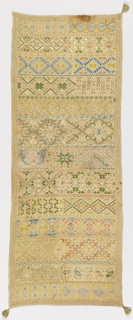 Long narrow sampler with tassels on three corners, embroidered with geometric pattern bands and deflected element work.