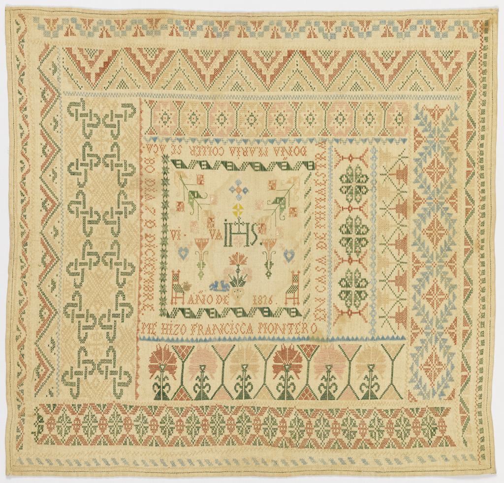 Center field with IHS and spot motifs, surrounded by concentric bands of floral, geometric and interlacing patterns, embroidered in pale blue, green, terra cotta and peach on a natural ground.