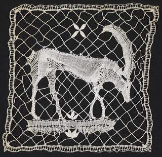 Bobbin lace square with a horned animal on a braided diamond-mesh ground.
