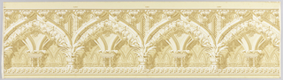 Almost four complete horizontal repeats of a Gothic arch of stone elaborately carved and heavily enriched with flowers and plant forms. Printed in white and brownish-green on pale green ground.