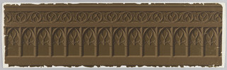 Gothic-style design containing pointed arches with tracery between clustered columns; above, band of tracery with trefoils and circles. Printed in shades of brown.