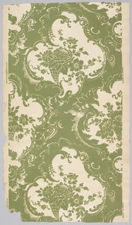Large-scale diaper pattern in Rococo-revival style. Inside the diaper is a floral bouquet. Printed in green on white satin ground.