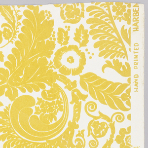 Large-scale, symmetrical formal floral and leaf design. Yellow flock on white ground. Straight across match.