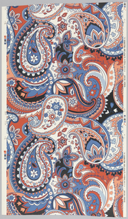 On white ground, overscaled, simplified paisley pattern in three shades of blue, black, red and pink.