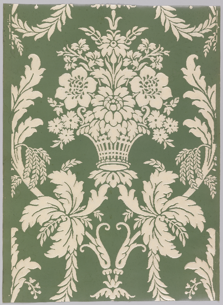 Embossed floral basket, surrounded by vining acanthus, printed in white on green satin ground.