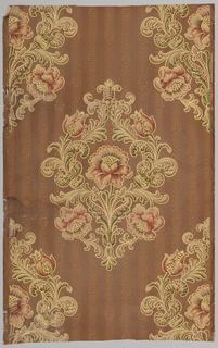 Floral medallion in red, cream and green, over brown weave-like stripe on brown satin ground.