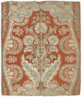 Brocaded silk damask fragment showing symmetrical design with large-scale floral motif derived from the pomegranate, on either side a lace-like serpentine. Rose ground, brocaded with silver and green silks. Both selvages present.