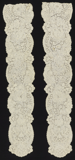 Brussels-style lace in a design that consists of asymmetric, dense pattern of floral and foliated forms containing in undulating ovals, connected by narrow serpentine bands and floral clusters.