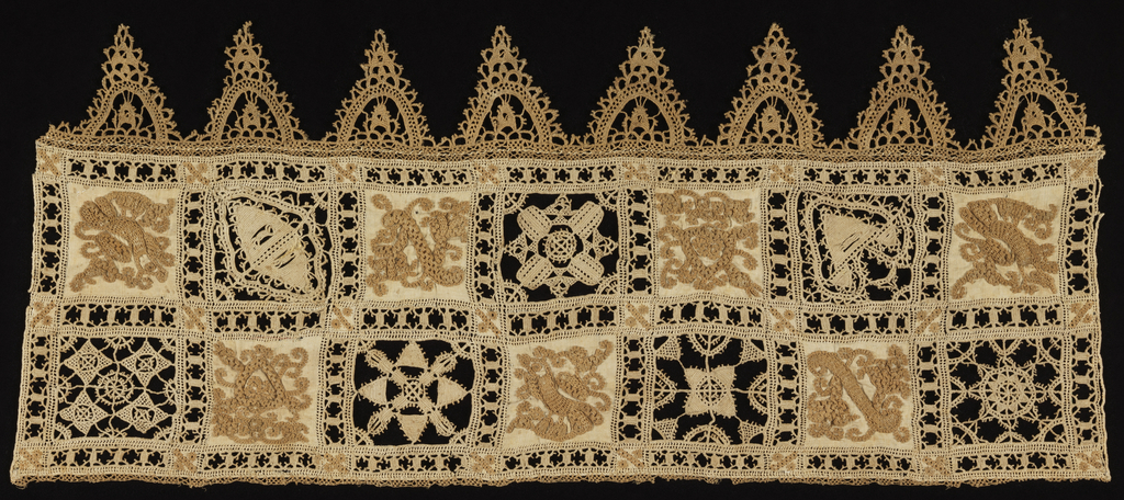 Double row containing alternate squares of embroidered linen cloth and insertions of needle lace (reticella) in geometric forms. Lower border is triangular pendants.