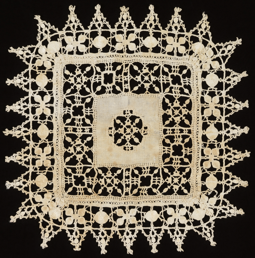 Center of cover is a woven square with an insertion of reticella. Around center piece are evenly spaced geometric motifs of reticella. Outer border has foliated forms and triangular pendants of reticella.