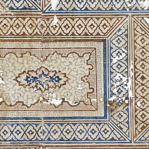 Variant of a brick or ashlar block pattern, printed in reddish-brown, blue and gray on white polished ground, horizontal rectangles arranged like stones in a wall, made up of scrollwork.