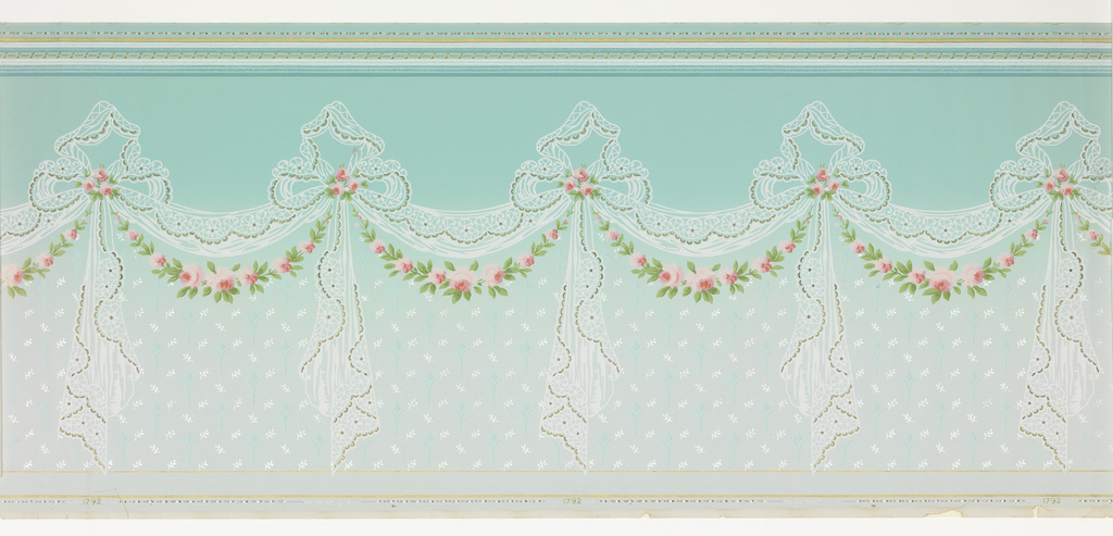 """Lacy swags, ends caught in bowknots with pendent ends. Garlands of roses and leaves festooned below swags, clusters of roses secured in bowknots. Lower portion of frieze ground scattered with tiny floral and foliate motifs. Top edge of frieze has numerous narrow stripes flanking a band of """"S"""" pattern. Lower edge has two fine stripes; printed in white, pink, coral, rose, mauve, greens, aqua, gilt and mica. Ground is pale aqua at top of frieze, shaded to very pale tint at bottom."""