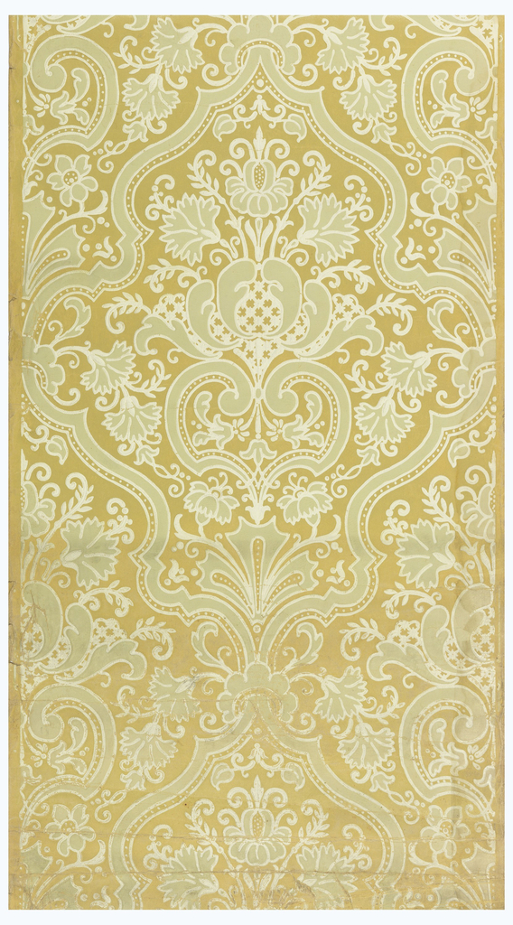 Very stylized floral motifs, set within a large-scale medallion. The design is printed in green and outlined in off-white. Printed on a yellow-ocher ground.