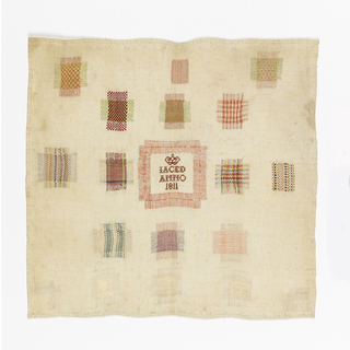 Fourteen darning crosses, inset patch in middle with crowned monogram, two inset corners and two decorative embroidered squares.