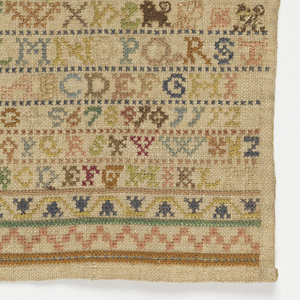 Small sampler with church at top and grapes in middle.