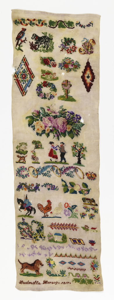 Spot motifs of animals, flowers, a house, a cross, and a dancing couple, with floral bands and two lines of text in unidentified script, in bright colors on a white ground.