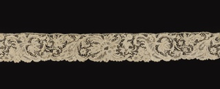 Border with a garland of scrolled floral and foliated forms in a repeat pattern.