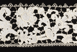 Pieced-together elements from a needle-lace floral vine border, with a delicate picot along the top edge.