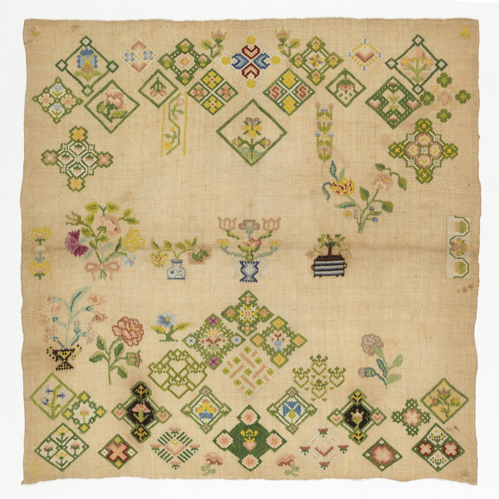 """Rococo"" embroidered sampler showing diamond designs, potted plants, and bouquets throughout the field."