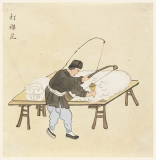 Figure of a Chinese man beating cotton on a broad, flat table. He is shown facing right in profile. Chinese characters in upper left.