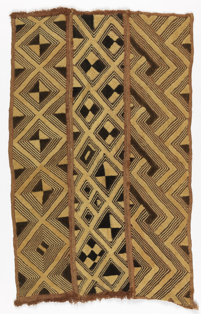 A rectangular panel formed of three narrow pieces stitched together on the long sides with buttonhole stitch. Each piece is patterned with different diamond and zigzag patterns with irregular fillings in cream and dark brown raffia pile with reddish-brown outlining stitch.