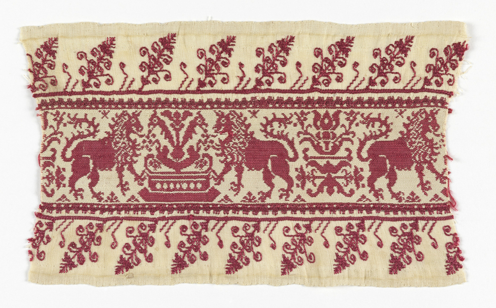 Woven band, red and white, with design of confronted lions, fountain; embroidered borders.