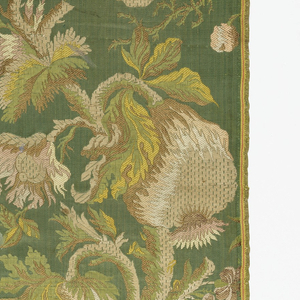 Blue-green satin, brocaded in white, rose, green and light brown. Pattern is of tree with large scale fruit.