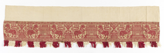 Woven fragment with design in red on cream colored ground. Fringed in red and white stripes.