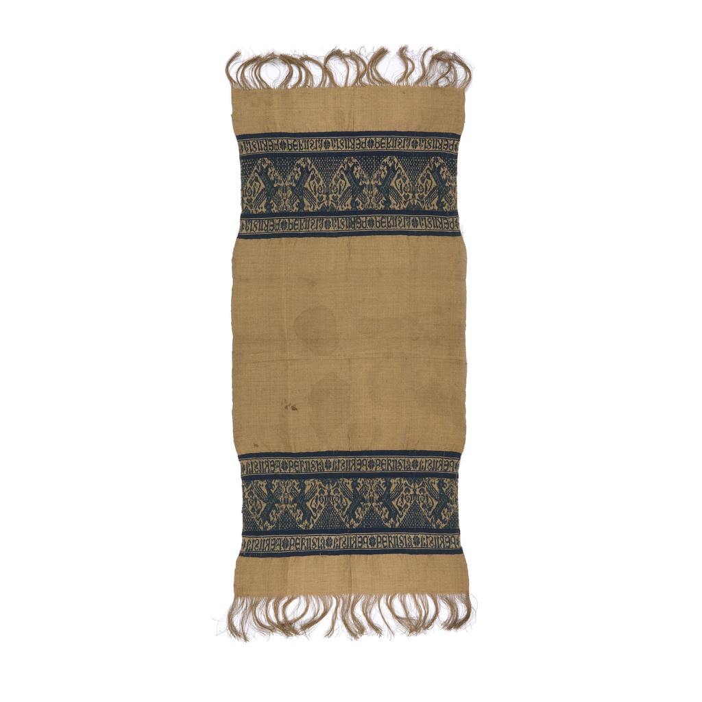 """At each end of the rectangular bast fiber diamond-twill towel, a blue cotton band with griffons alternating with a symmetrical geometric tree. The band is bordered at top and bottom by the repeated words """"Perugia"""" alternately in mirror image. Warp fringe at end about 10.2cm or 4"""" long."""