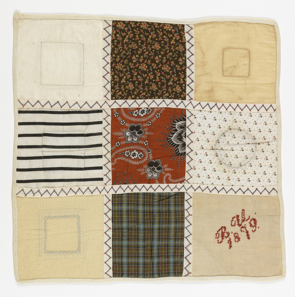 Nine squares of patches on printed cotton and woven fabric.  The squares are separated with woven tape.