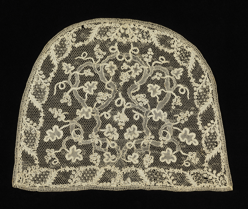 """Semi-circular cap crown in needle lace with a design of twisting vines and grapes. Commonly called """"Point d'Argentan"""""""