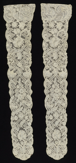 Pair of Brussels-style cap streamers with a vertical zig-zag pattern enclosing floral forms.