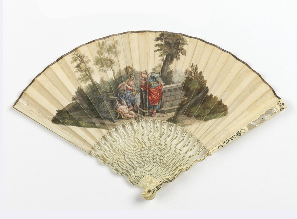 Pleated fan with a gouache painted paper leaf showing the story of Vertumnus and Pomona by the well, with a putto reclining nearby. The ivory sticks are carved like a swimming dolphin with scales of silvered piqués. The guards have applied figures of soldiers in mother-of-pearl.