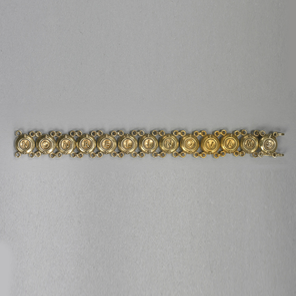 "Bracelet of thirteen linked disks with letters spelling ""NONRELINQUES"" on one side, and ""NONRELINQUAM"" on the other."