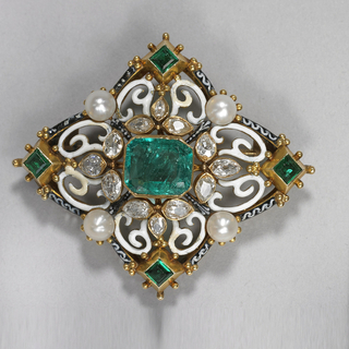 Gold and emamel brooch with four button pearls, twelve diamons, one octagonal emerald, and four square emeralds.